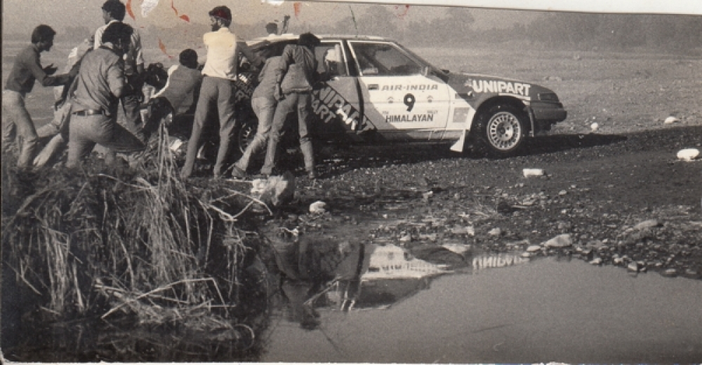 India  Photograph  Air India  9th Himalayan Car Rally  Driver  Phil Young's...Car Stranded At River Point  Reduced Photo  # 24797 d